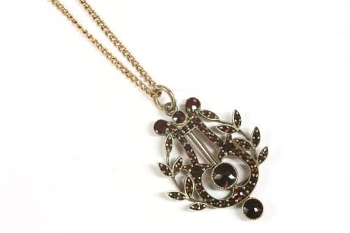 Lot 40-A Victorian bohemian garnet set lyre and laurel pendant