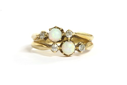 Lot 10-Two three stone opal and diamond rings joined as one