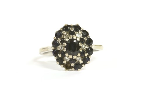 Lot 11-A sapphire and diamond cluster ring