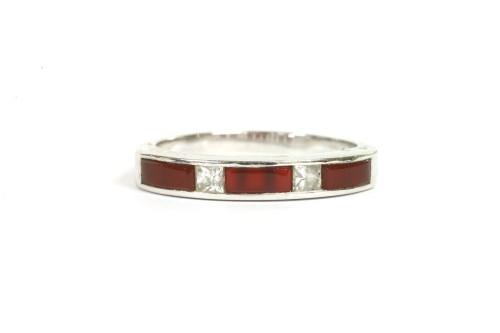 Lot 9-A 9ct white gold diamond and cornelian half eternity ring