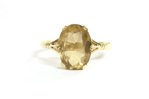Lot 38-A single stone oval cut citrine ring