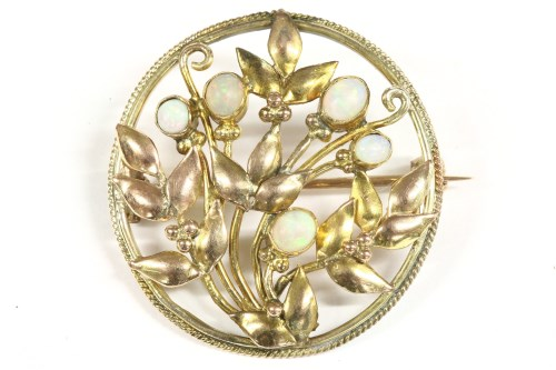 Lot 22 - An Arts and Crafts style opal set circular brooch