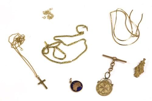 Lot 29-A 9ct gold T-bar with a 9ct gold St John Ambulance medallion