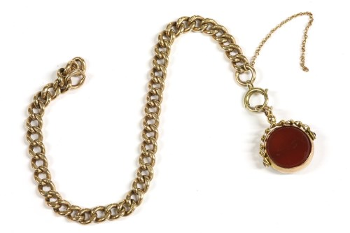 Lot 8-A 9ct gold curb link bracelet with a 9ct gold Cornelian and bloodstone swivel fob