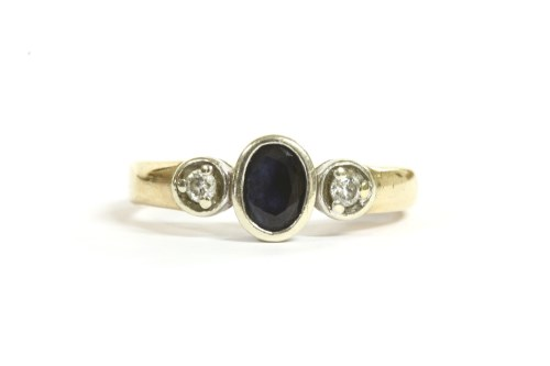 Lot 30-A 9ct gold three stone sapphire and diamond ring