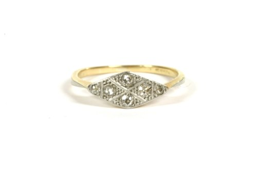 Lot 5-An Art Deco gold four stone diamond lozenge shaped ring