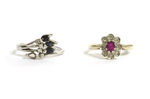 Lot 14-A 9ct gold ruby and diamond cluster ring