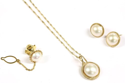 Lot 44-A gilt metal mabé pearl pendant