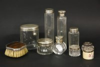 Lot 60 - A collection of silver topped dressing table bottles