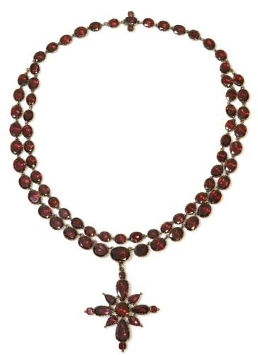 Lot 278 - A late 18th century two row garnet set rivière with a garnet set cruciform pendant