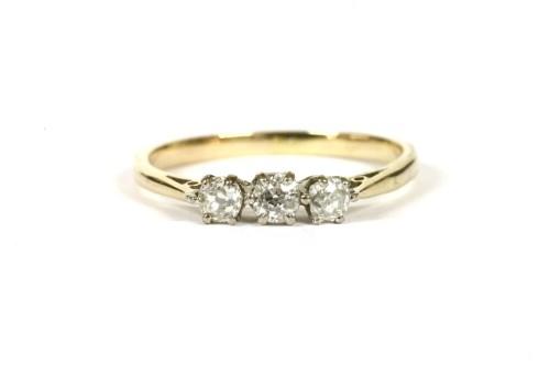 Lot 7-A gold three stone diamond ring