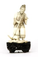 Lot 77 - A Japanese sectional carved ivory figure