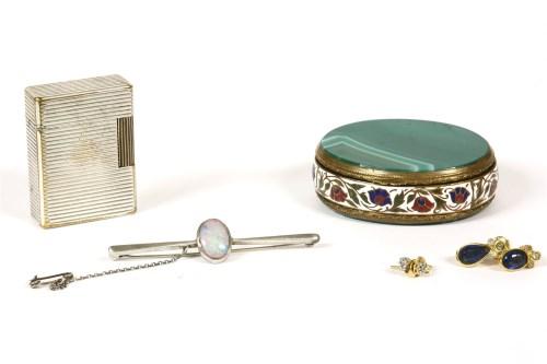 Lot 75-A single stone oval cabochon opal bar brooch