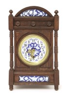 Lot 17-An Aesthetic oak and enamelled mantel clock