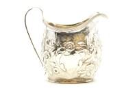 Lot 94 - A Georgian silver cream jug