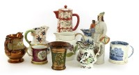 Lot 67-A collection of Staffordshire pottery jugs and tankards