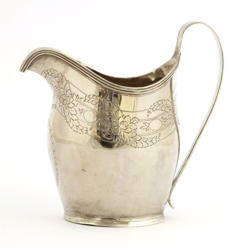 Lot 50-A George III silver milk jug