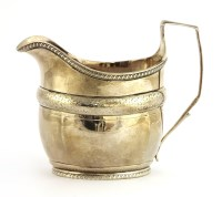 Lot 49-A George III silver cream jug