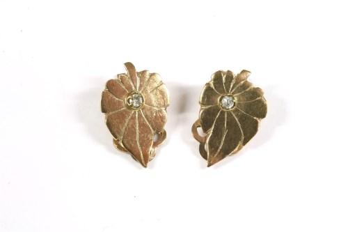 Lot 21-A pair of single stone diamond leaf shaped earrings