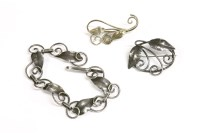 Lot 23-An Arts & Crafts silver bracelet and brooches