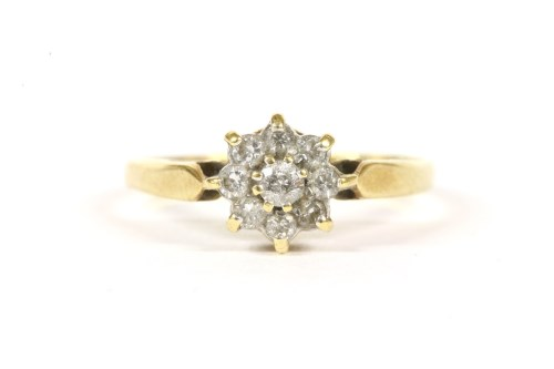 Lot 3-An 18ct gold diamond daisy cluster ring