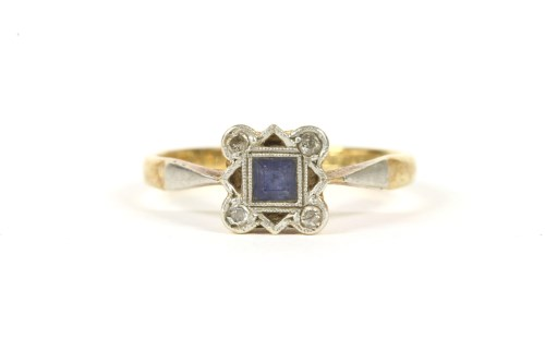 Lot 14-An Art Deco gold sapphire and diamond square cluster ring