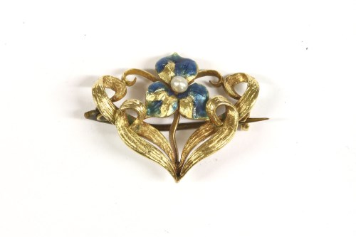 Lot 23-An Art Nouveau seed pearl blue enamel Iris brooch