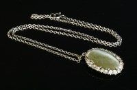 Lot 72-A quartz cat's eye and diamond cluster pendant