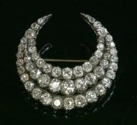 Lot 37-A late Victorian three row diamond closed crescent brooch