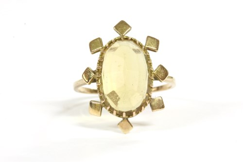 Lot 39-A 9ct gold single stone oval cheque cut citrine ring