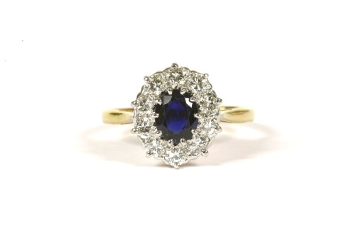 Lot 5-A sapphire and diamond oval cluster ring