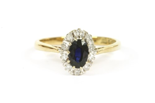 Lot 10-A 9ct gold sapphire and diamond cluster ring