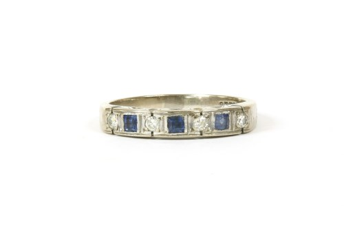 Lot 12-A white gold seven stone diamond and sapphire ring