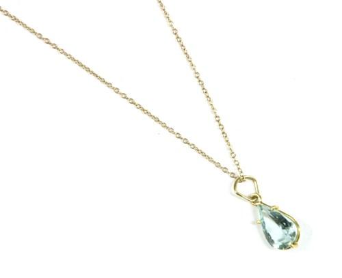 Lot 9-A single stone pear shaped aquamarine pendant