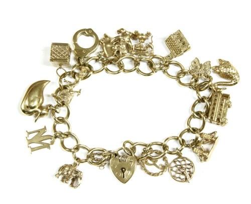 Lot 13-A 9ct gold curb link charm bracelet