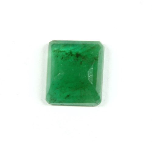 Lot 2-An unmounted emerald cut emerald