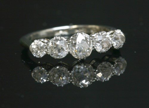 Lot 42-A graduated five stone diamond ring with old European cut diamonds
