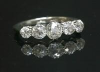 Lot 42-A graduated five stone diamond ring with old European cut diamonds