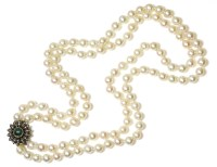 Lot 36-A two row uniform cultured pearl necklace with an emerald cabochon and diamond floral cluster clasp