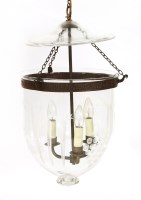 Lot 36 - A modern ceiling-mounted clear glass hall/storm light