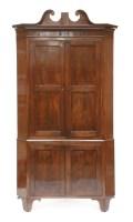 Lot 71 - A George III mahogany standing corner cupboard