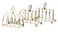 Lot 48-A pair of silver toast racks