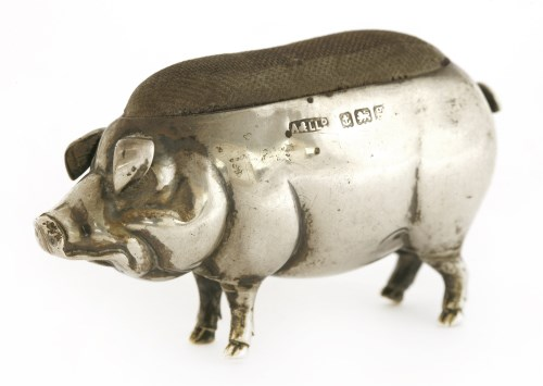 Lot 20-An Edwardian novelty silver pincushion