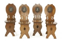 Lot 507-A set for four George II mahogany hall chairs