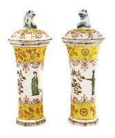 Lot 537 - A pair of Quimper pottery vases and covers