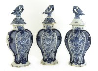 Lot 507-A garniture of three blue and white Dutch delft vases and covers