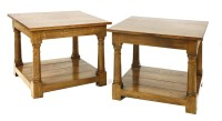 Lot 573-A pair of solid oak lamp tables