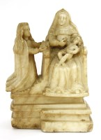 Lot 562-An alabaster figure of the Virgin and Child