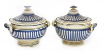 Lot 502-A pair of French faience tureens and covers