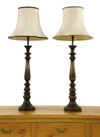 Lot 551 - A pair of turned and stained wood table lamps